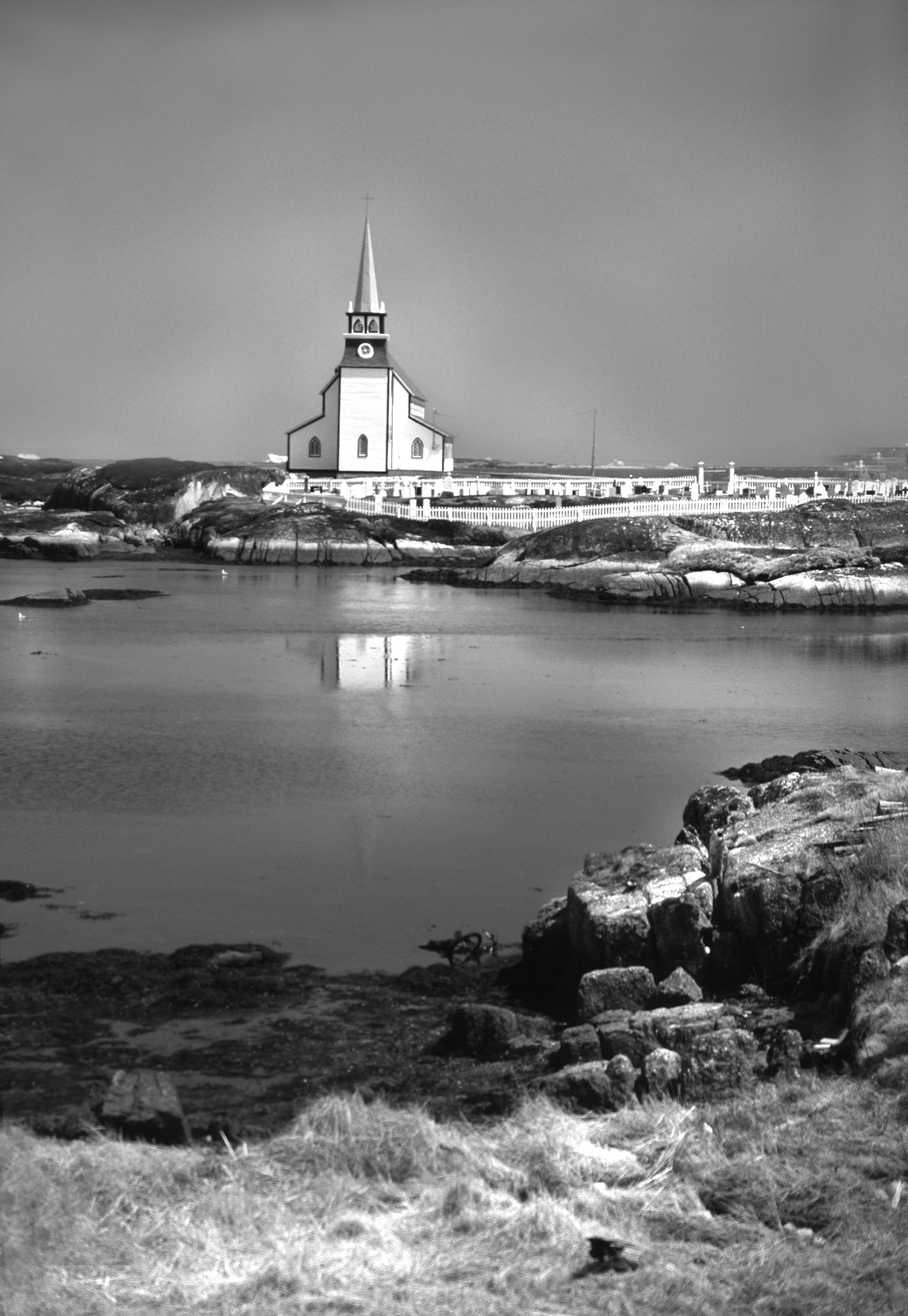 White Church Next to Body of Water