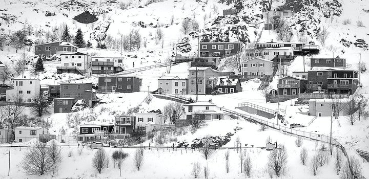 Village on Mountain Covered With Snows