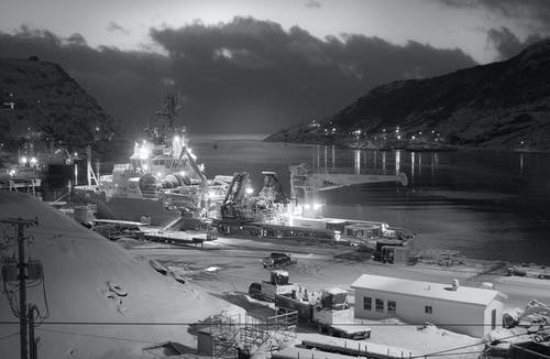 Ship Near on Dock in Grayscale Photography