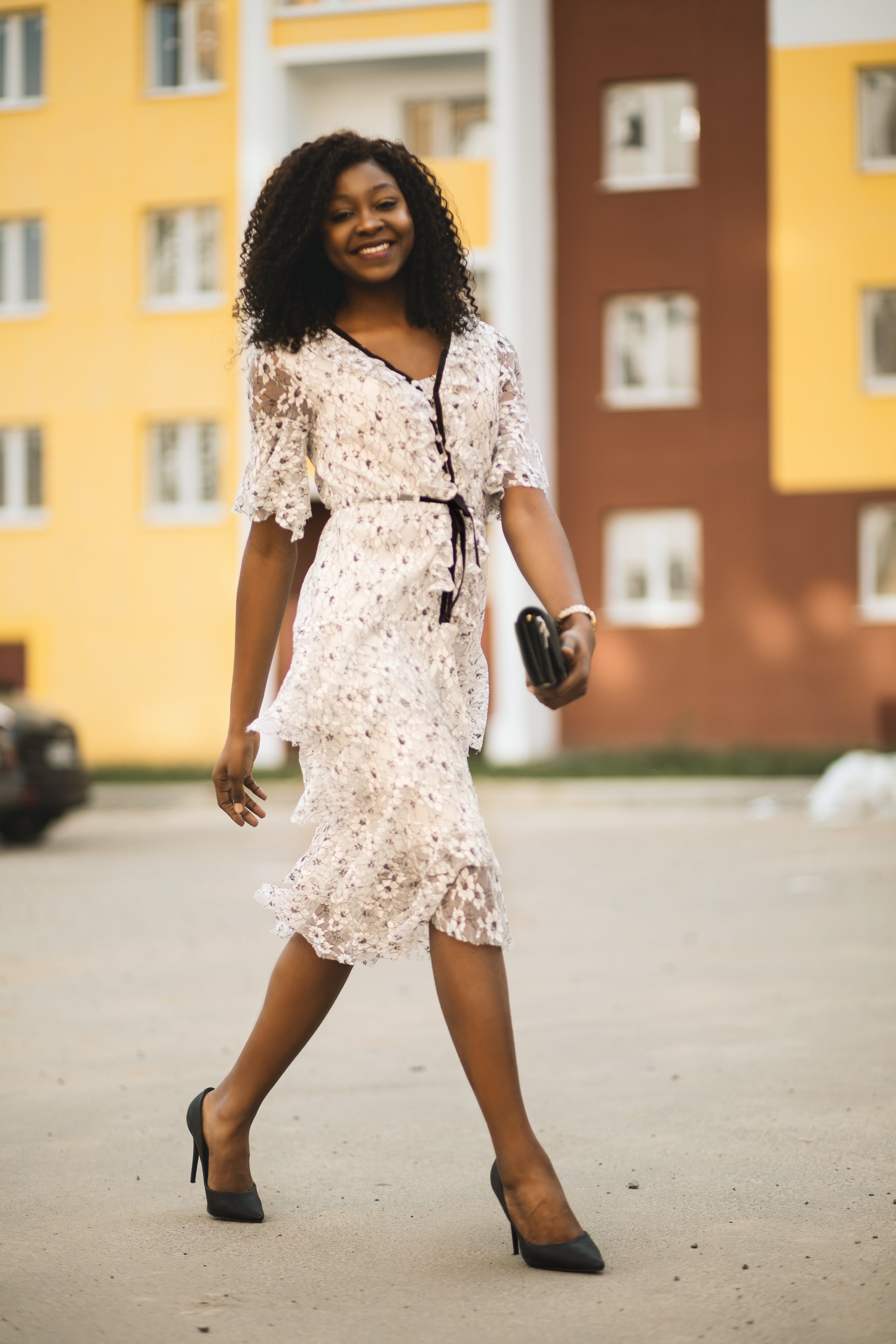 Smiling Woman Wearing White Dress