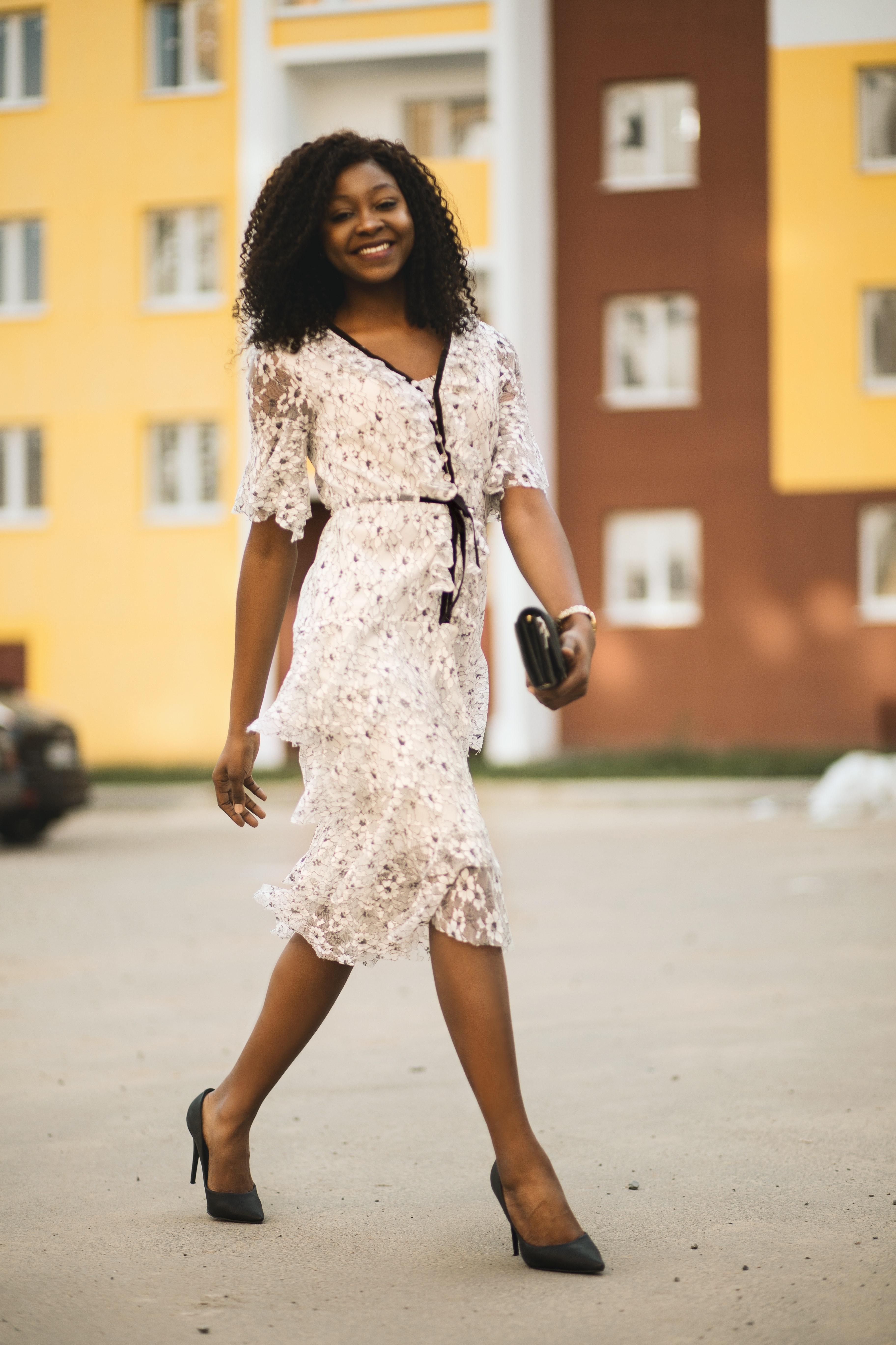074d8b79c Smiling Woman Wearing White Dress · Free Stock Photo