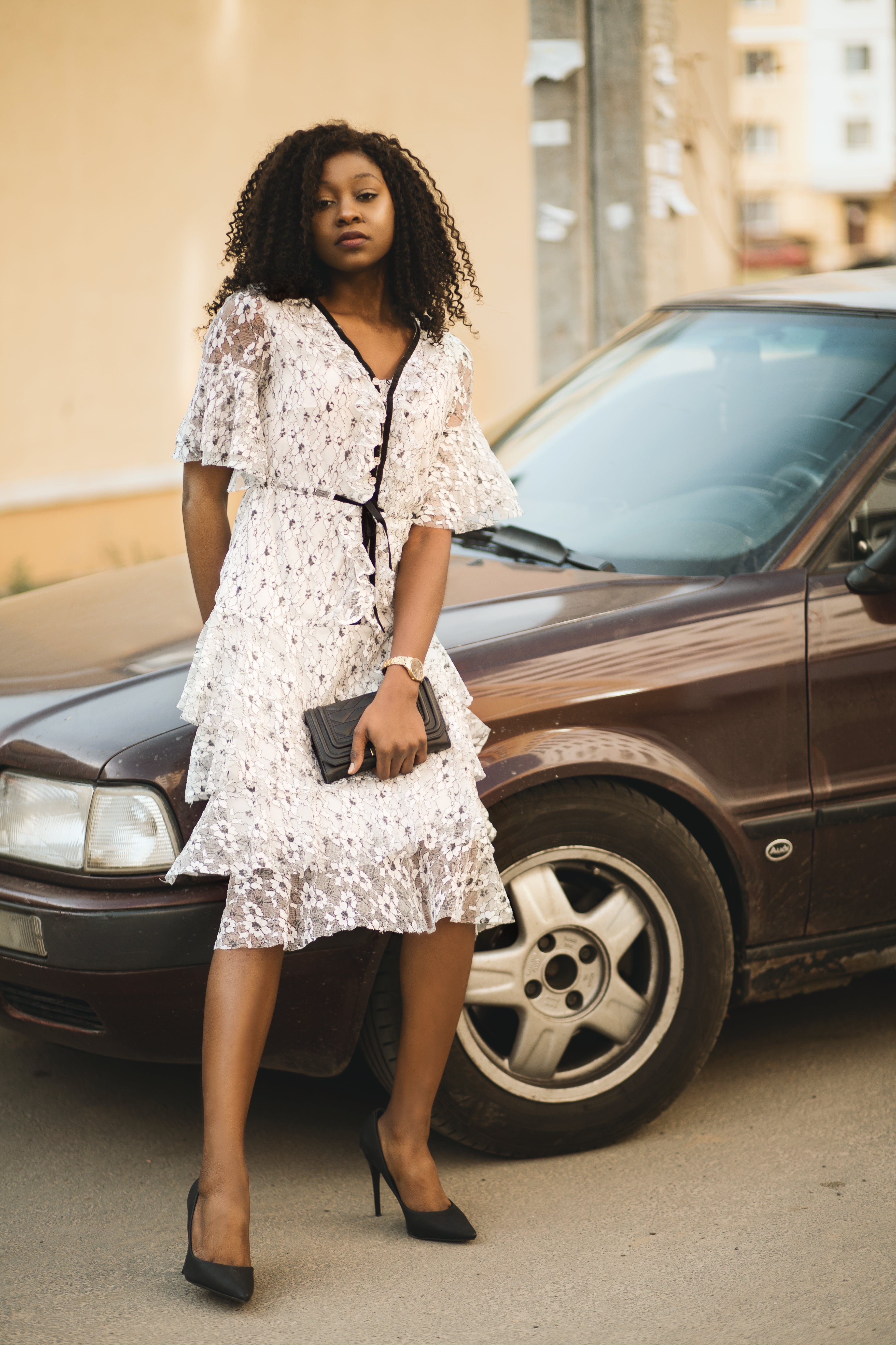 Woman Wearing White Dress Leaning on Brown Vehicle