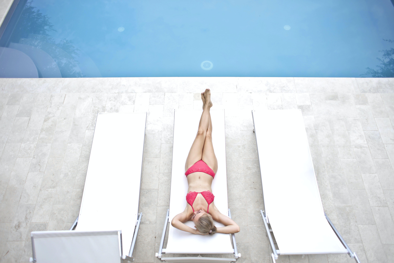 Woman Lying on White Sun Lounger