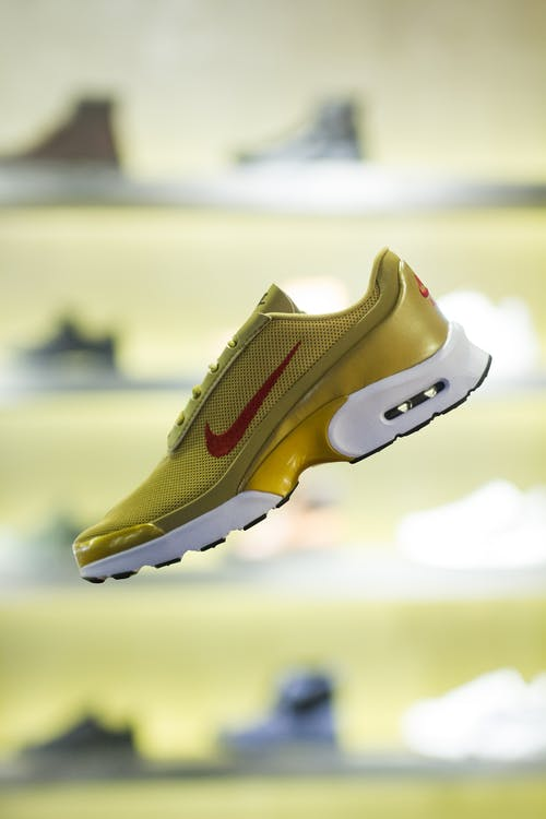 Stylish yellow running shoe in modern store