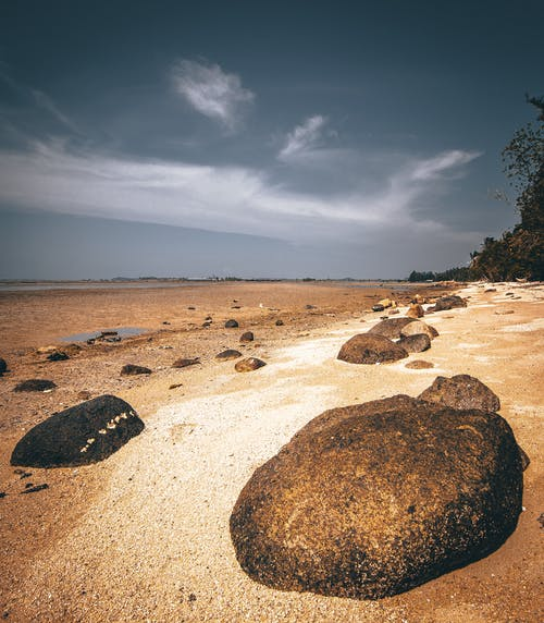 Photo Of Rocks On Seashore