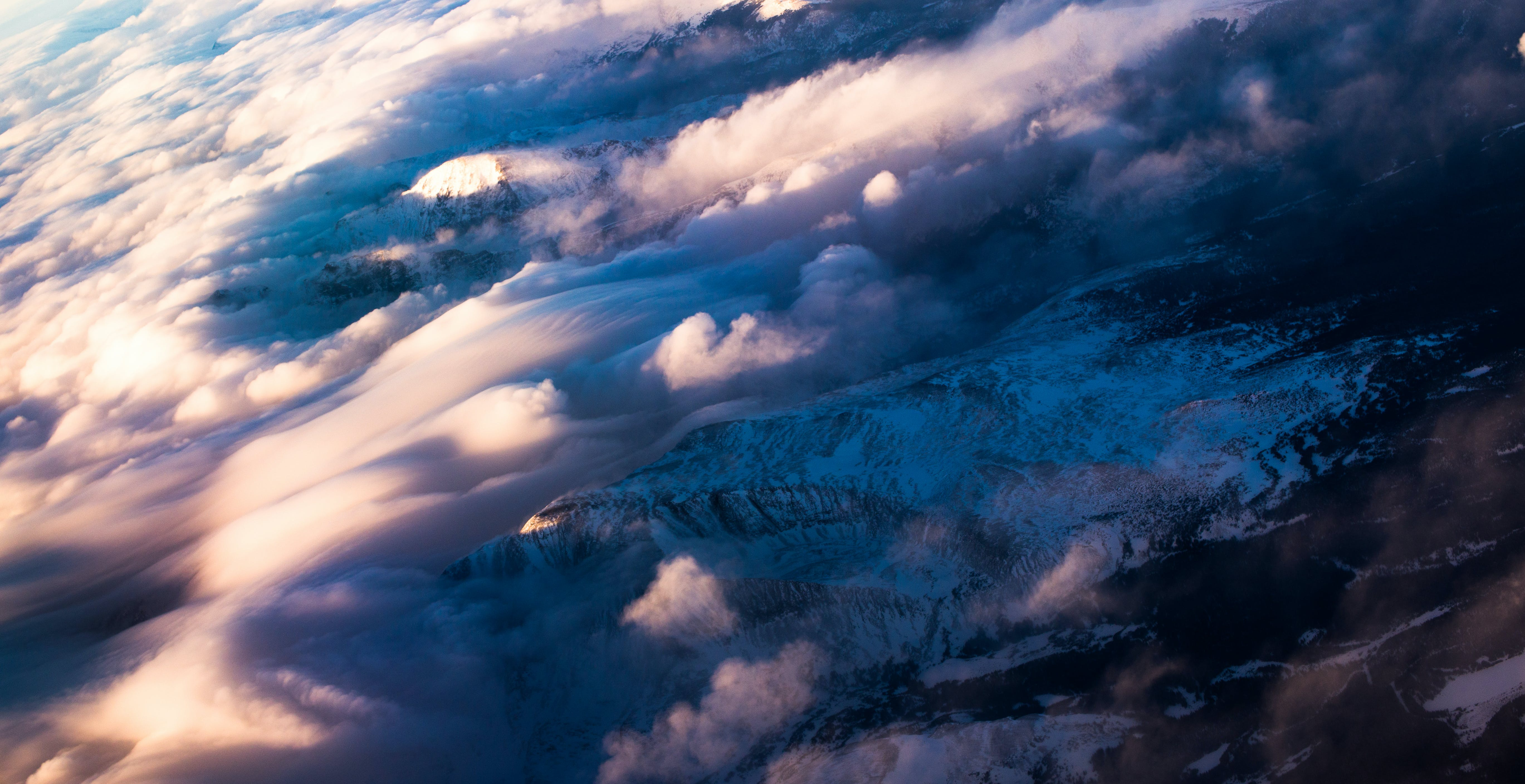 Aerial Photography of White Clouds over Mountain
