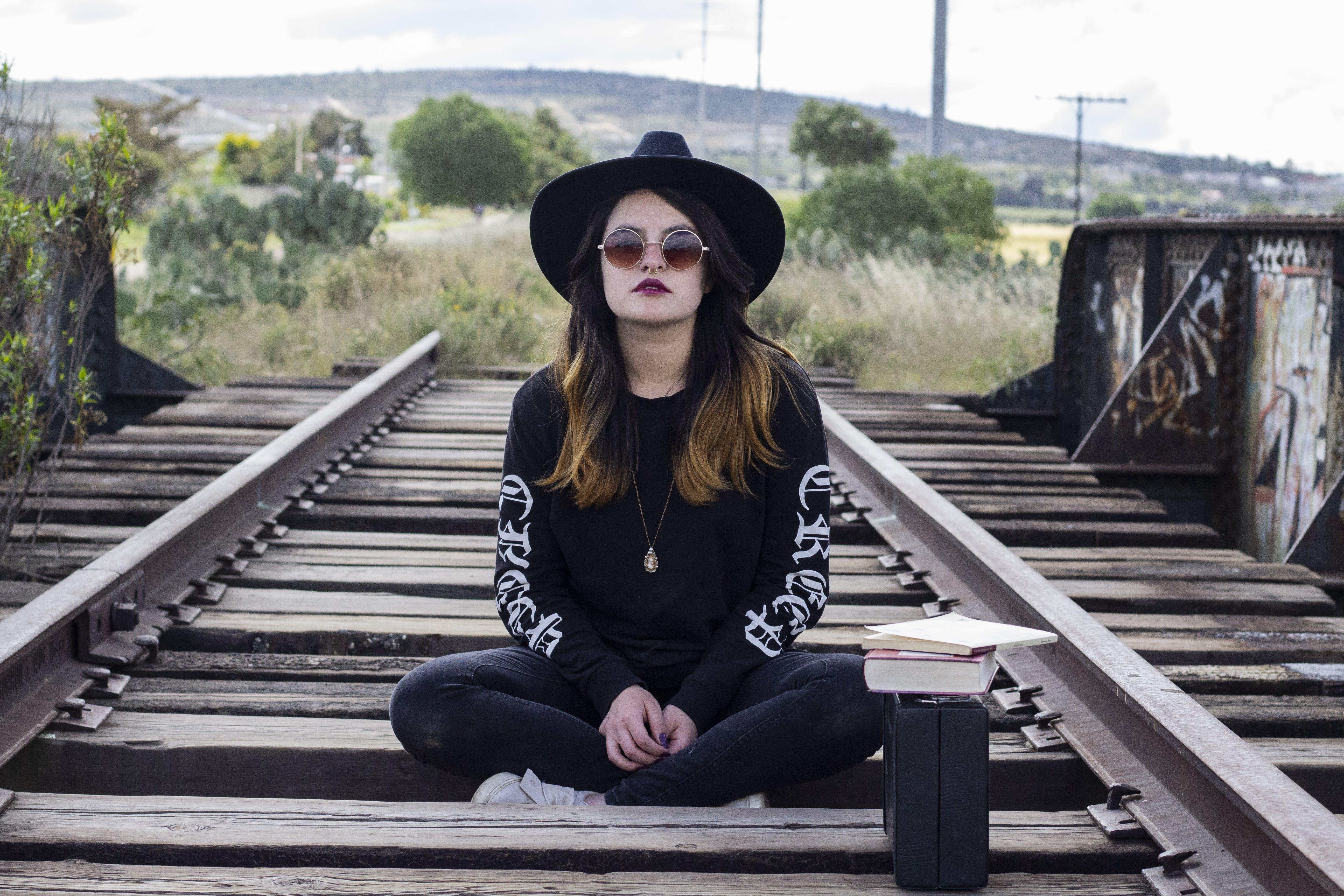 Woman Sitting on Railway