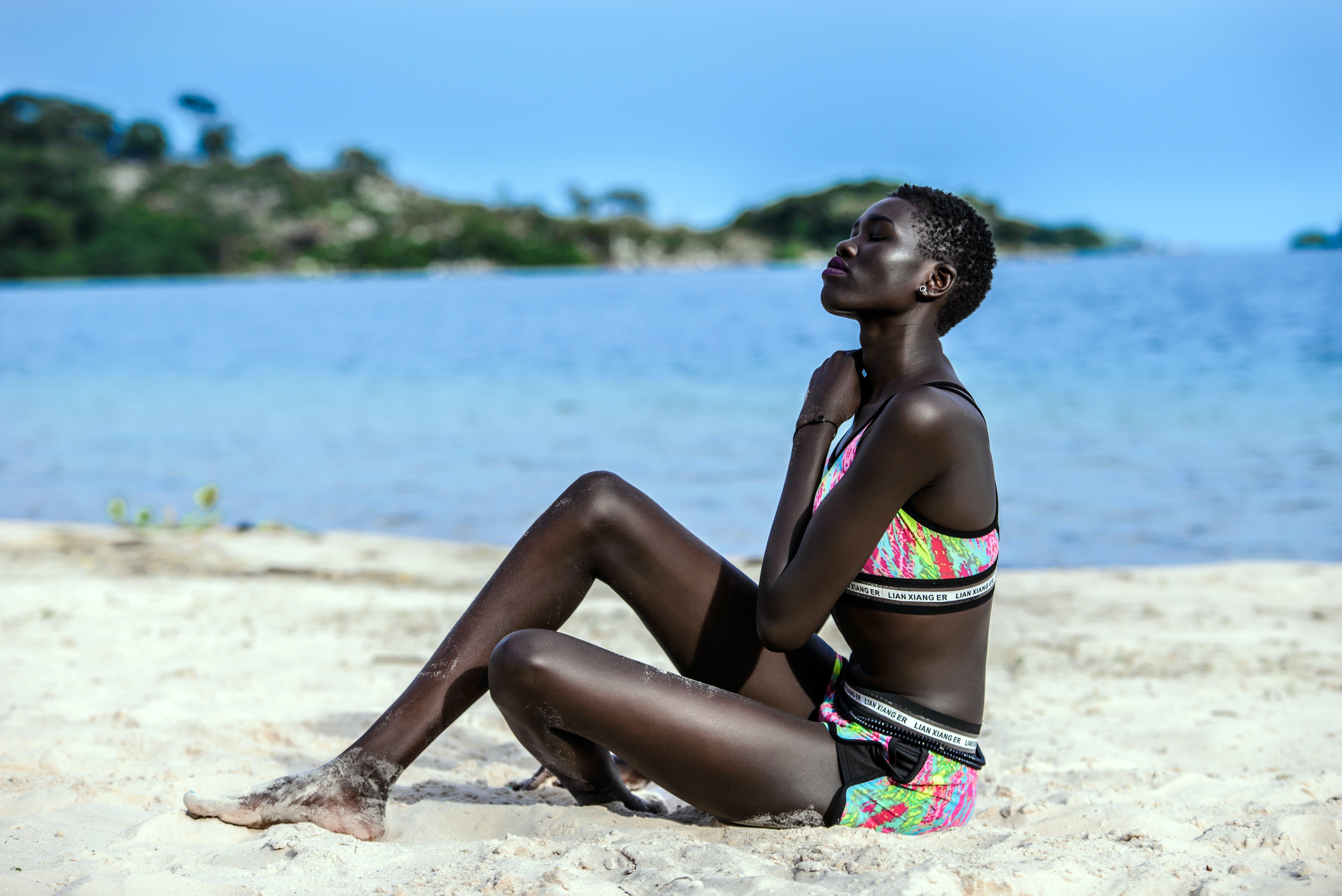 Woman Sitting on Beach Sands