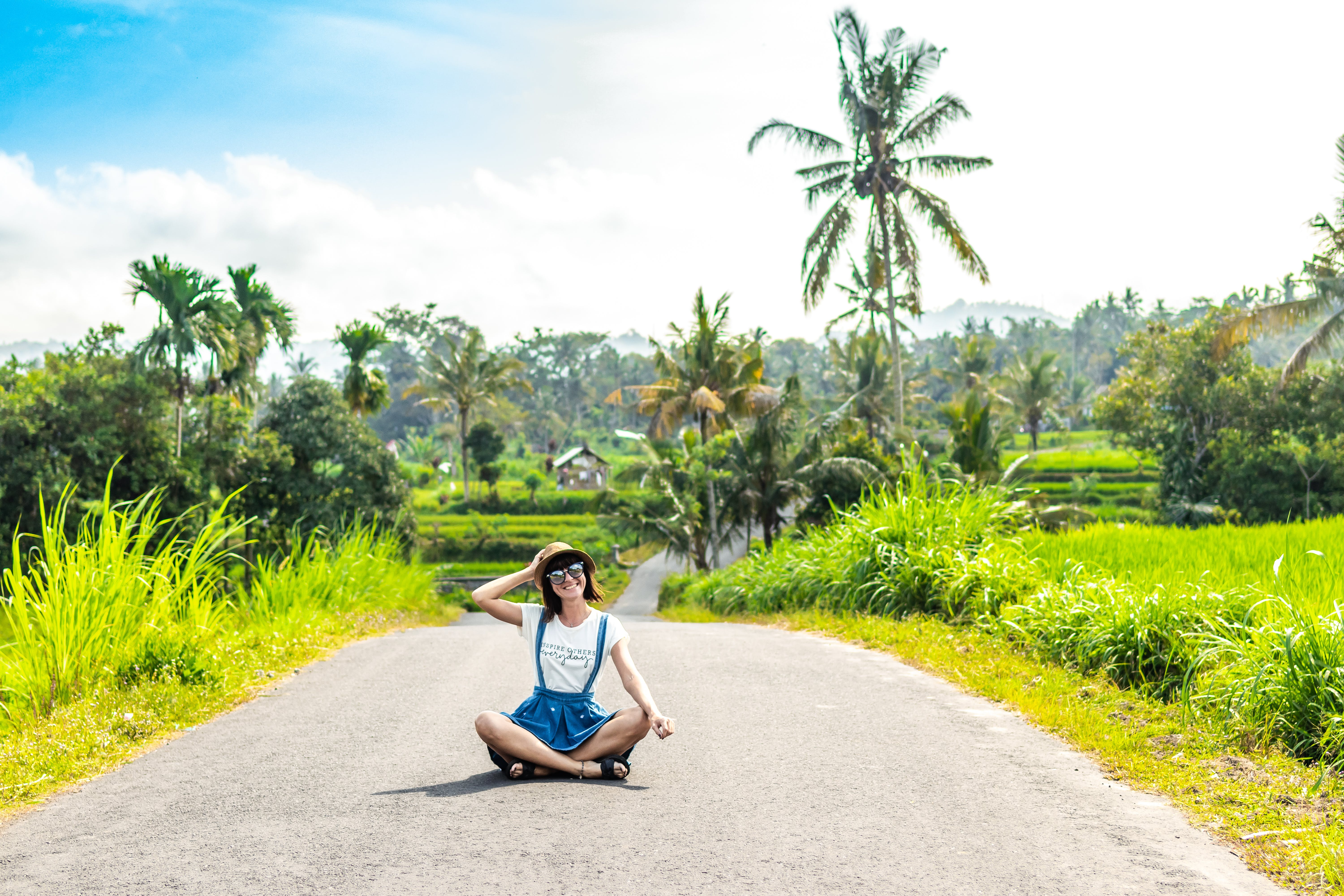 Woman Sitting on Road