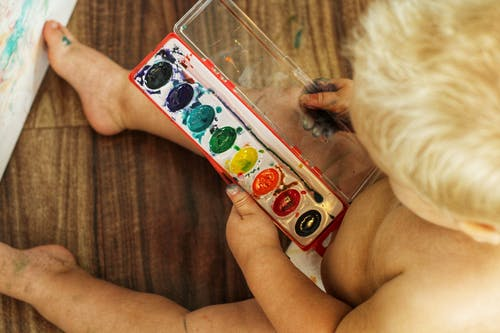 Child Playing with Water Colours