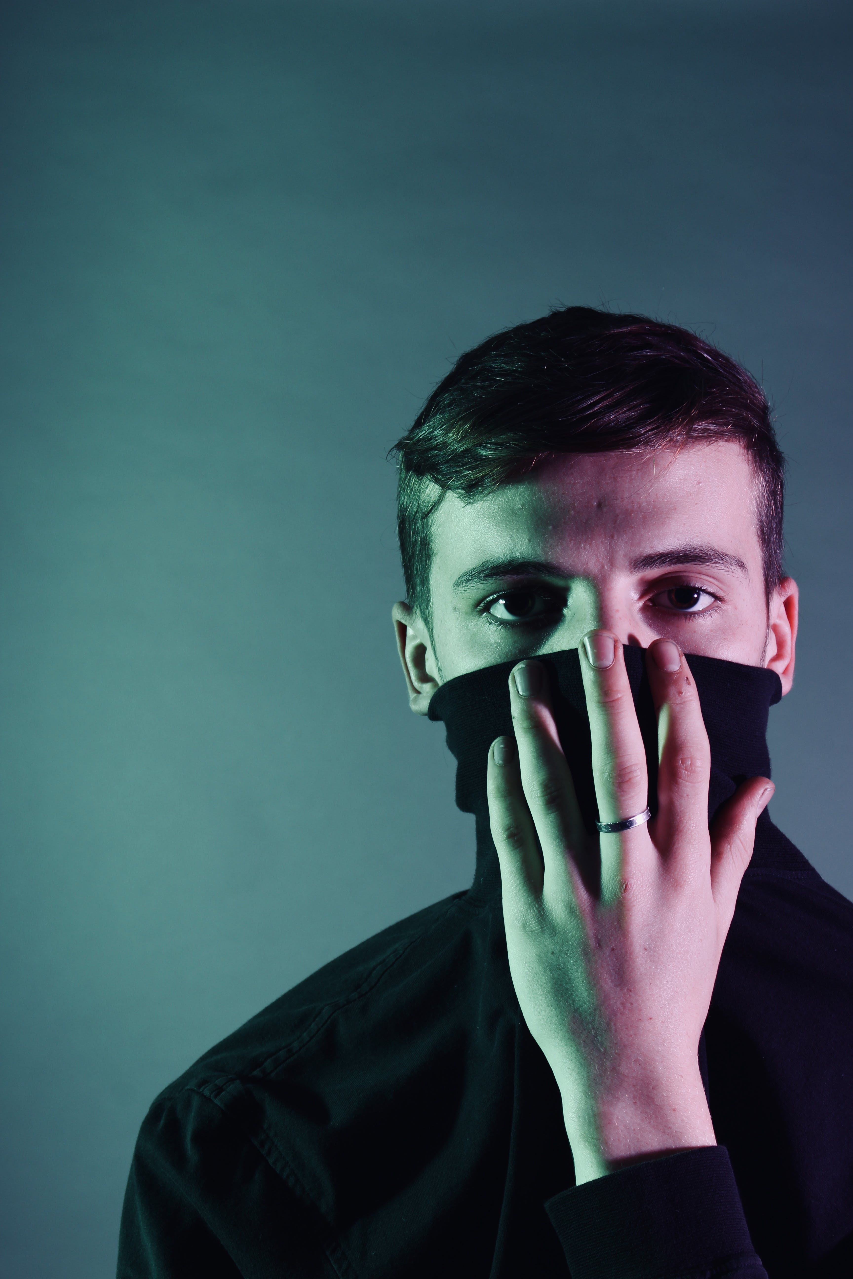 Man Holding Black Mask