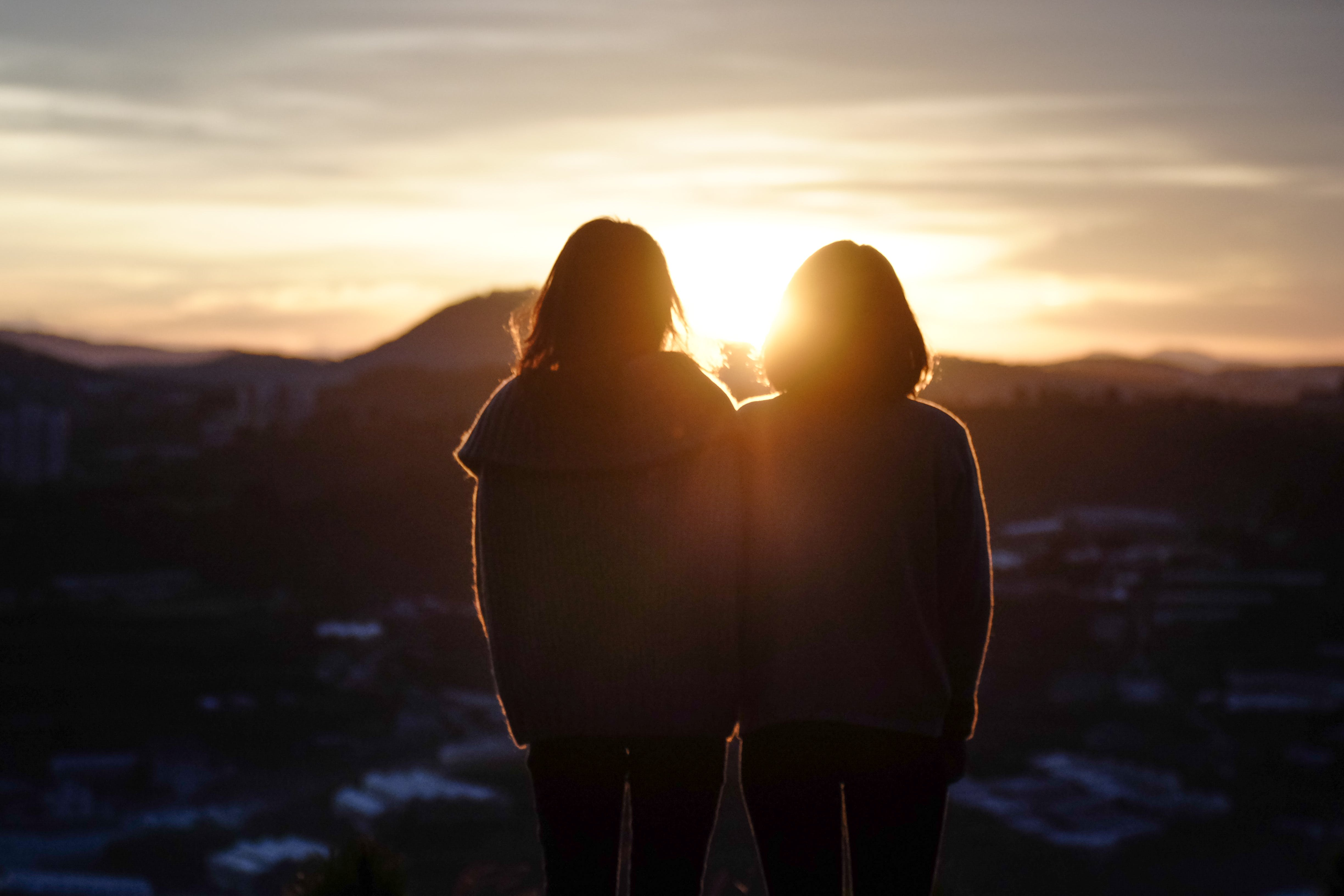 Silhouette of Two Woman Standing