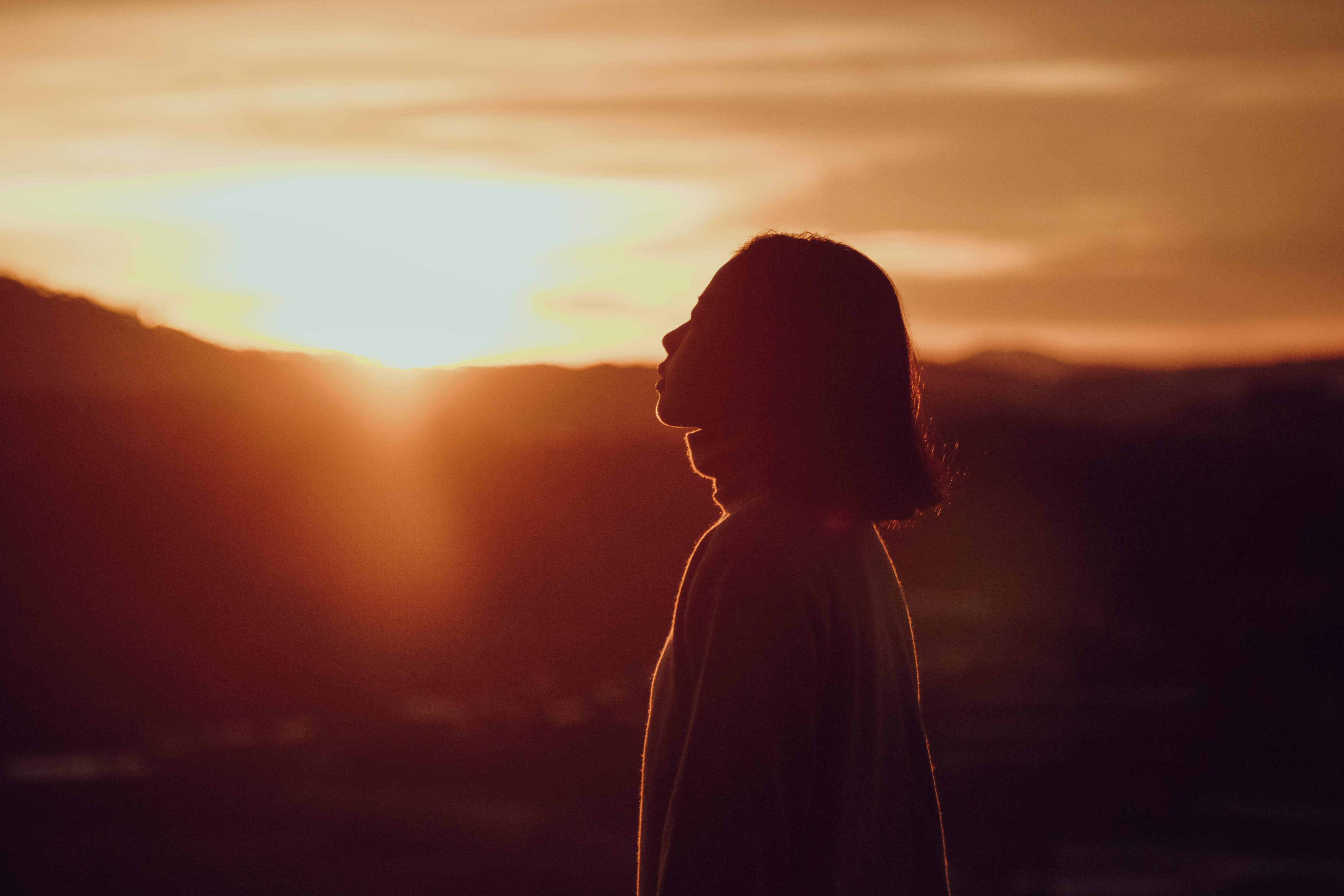 Silhouette Photography of Woman at Golden Hour