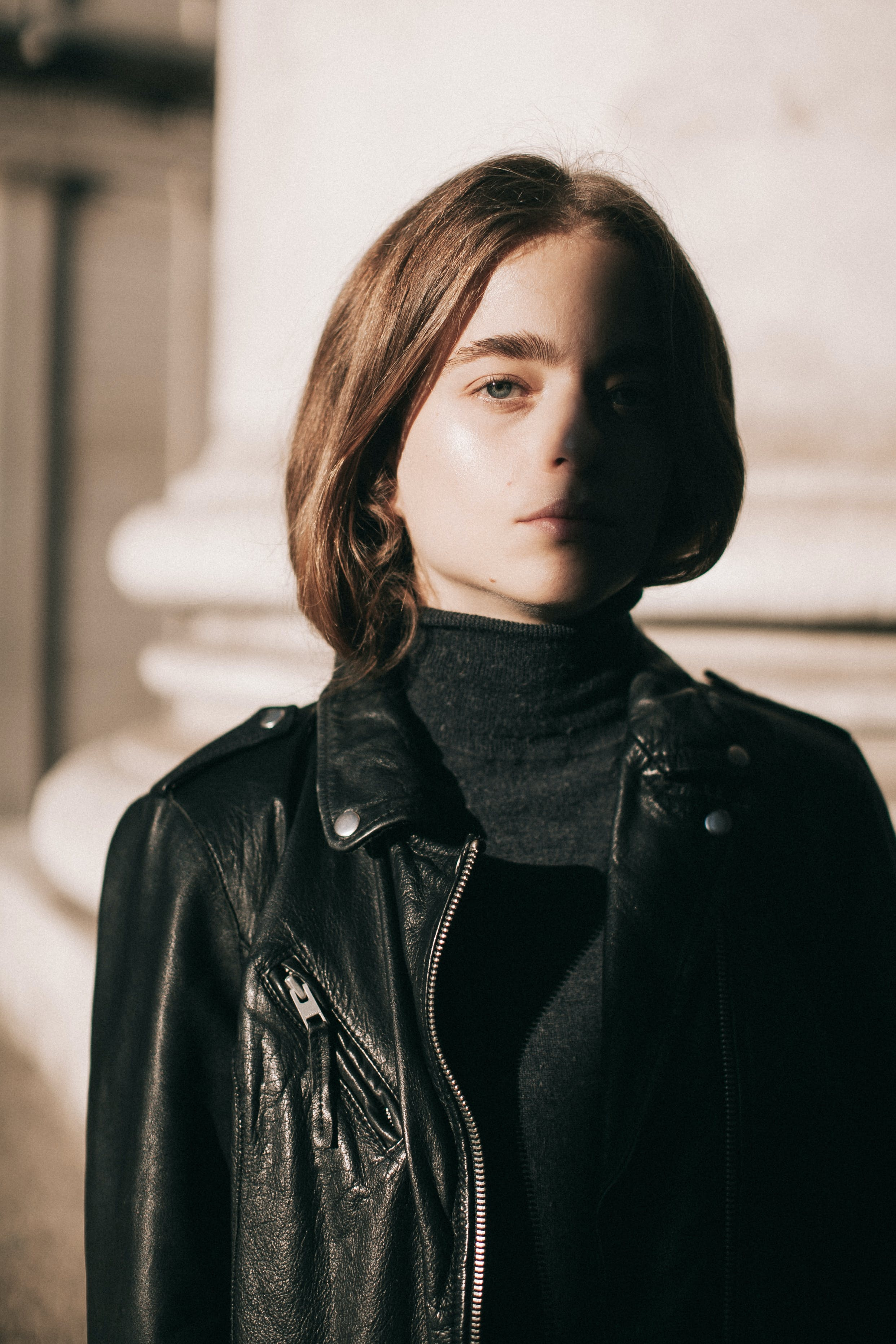 Close-Up Photo of Woman Wearing Leather Jacket