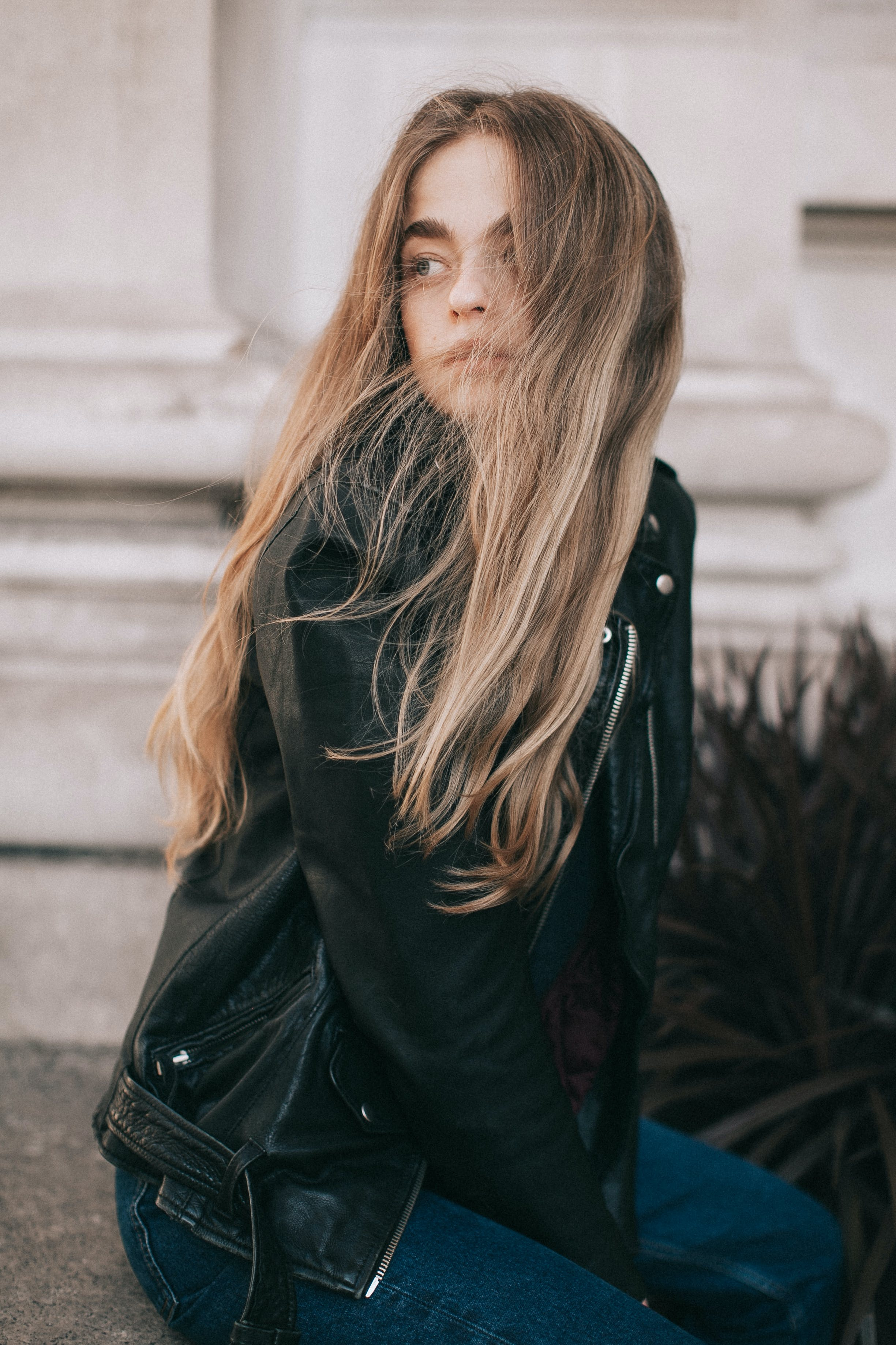 Photo of Woman Wearing Black Leather Jacket