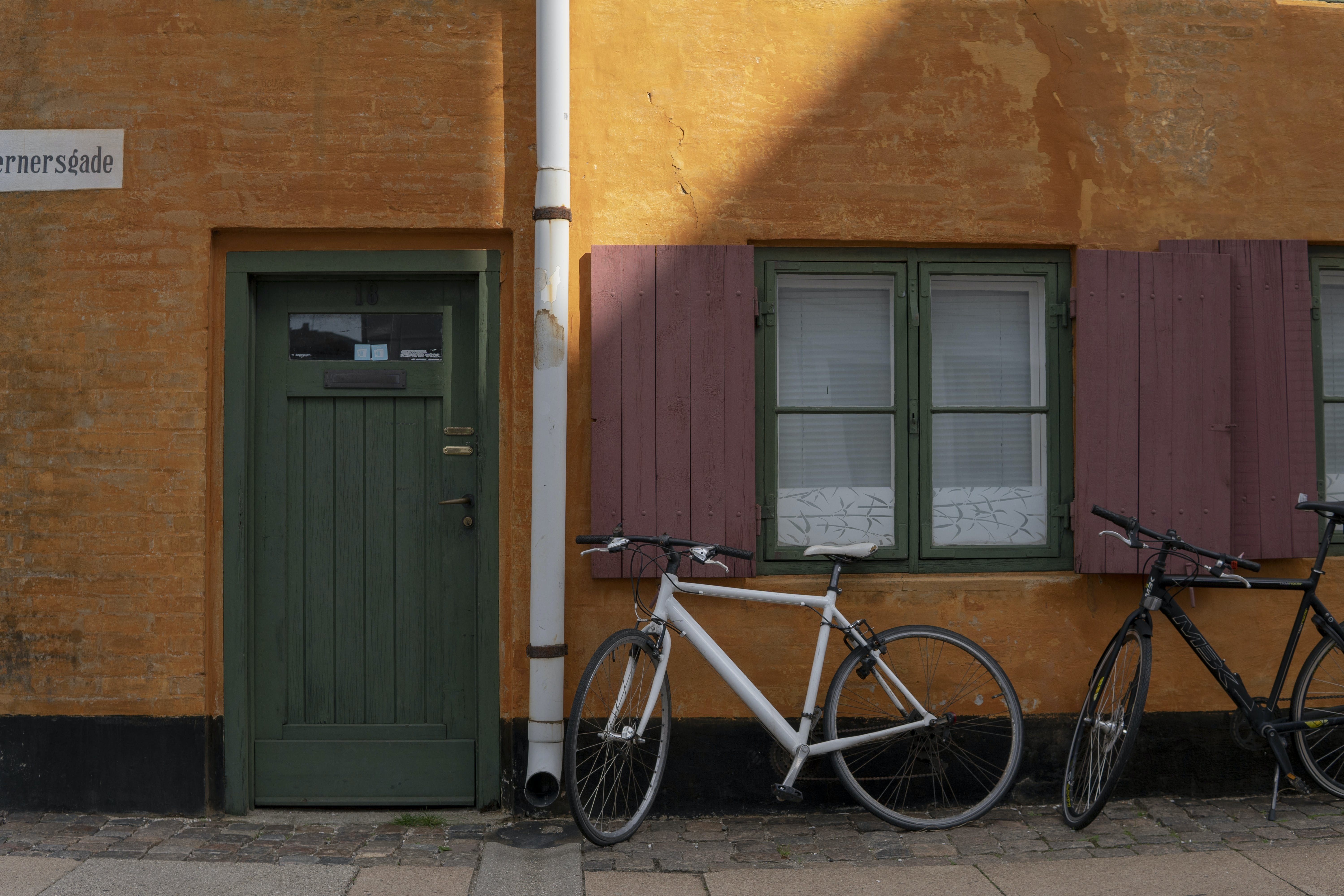 Bicycles Parked by Building