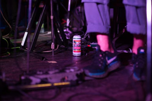 Selective Photo of a Can of Beer on The Floor