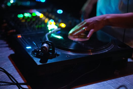 Person Playing Dj Controller