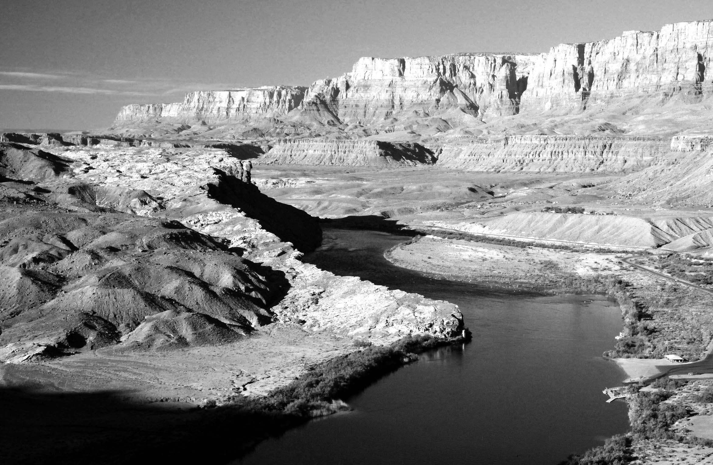 Black and White Photo of Mountains and River