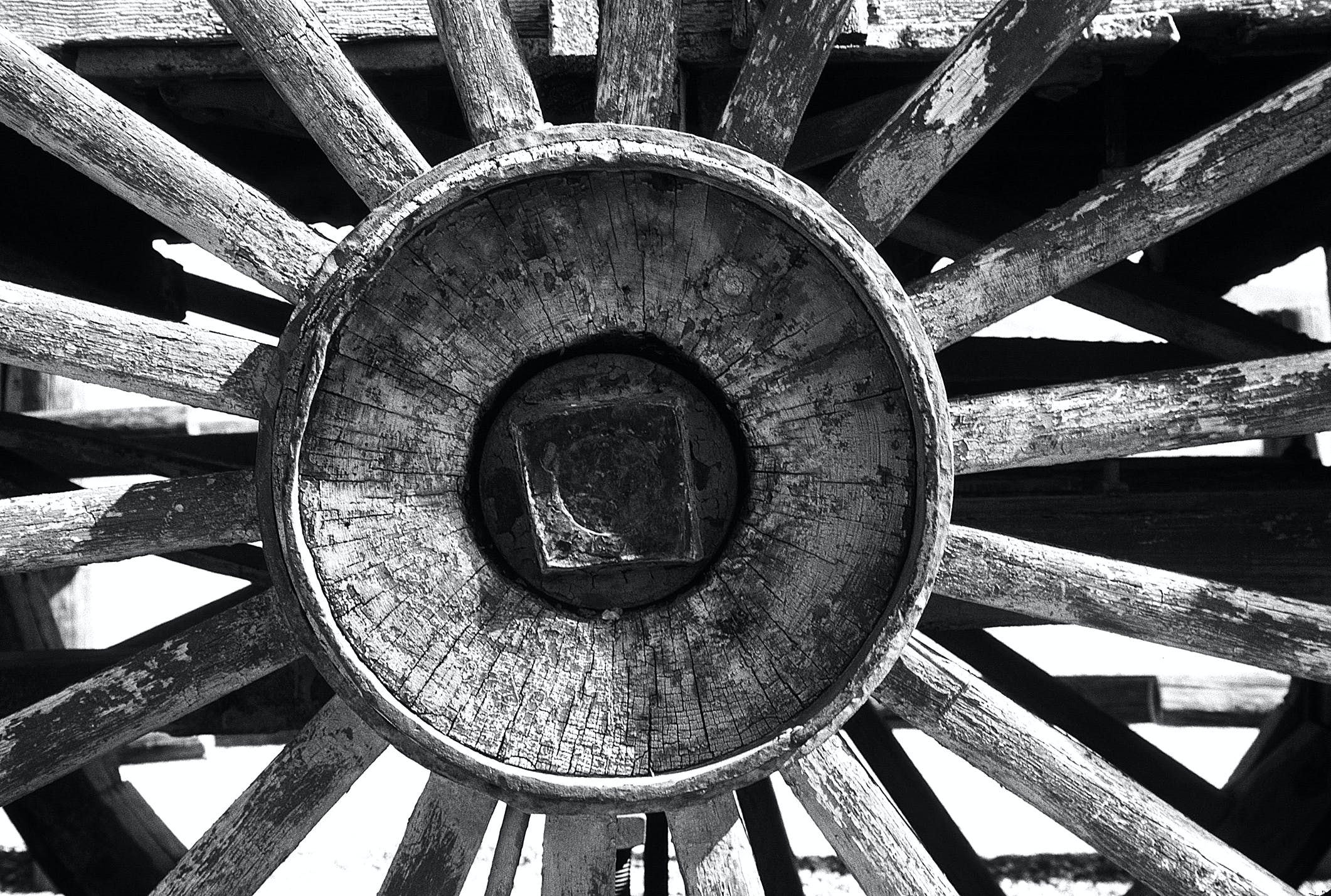 Grayscale Photography of Carriage Wheel