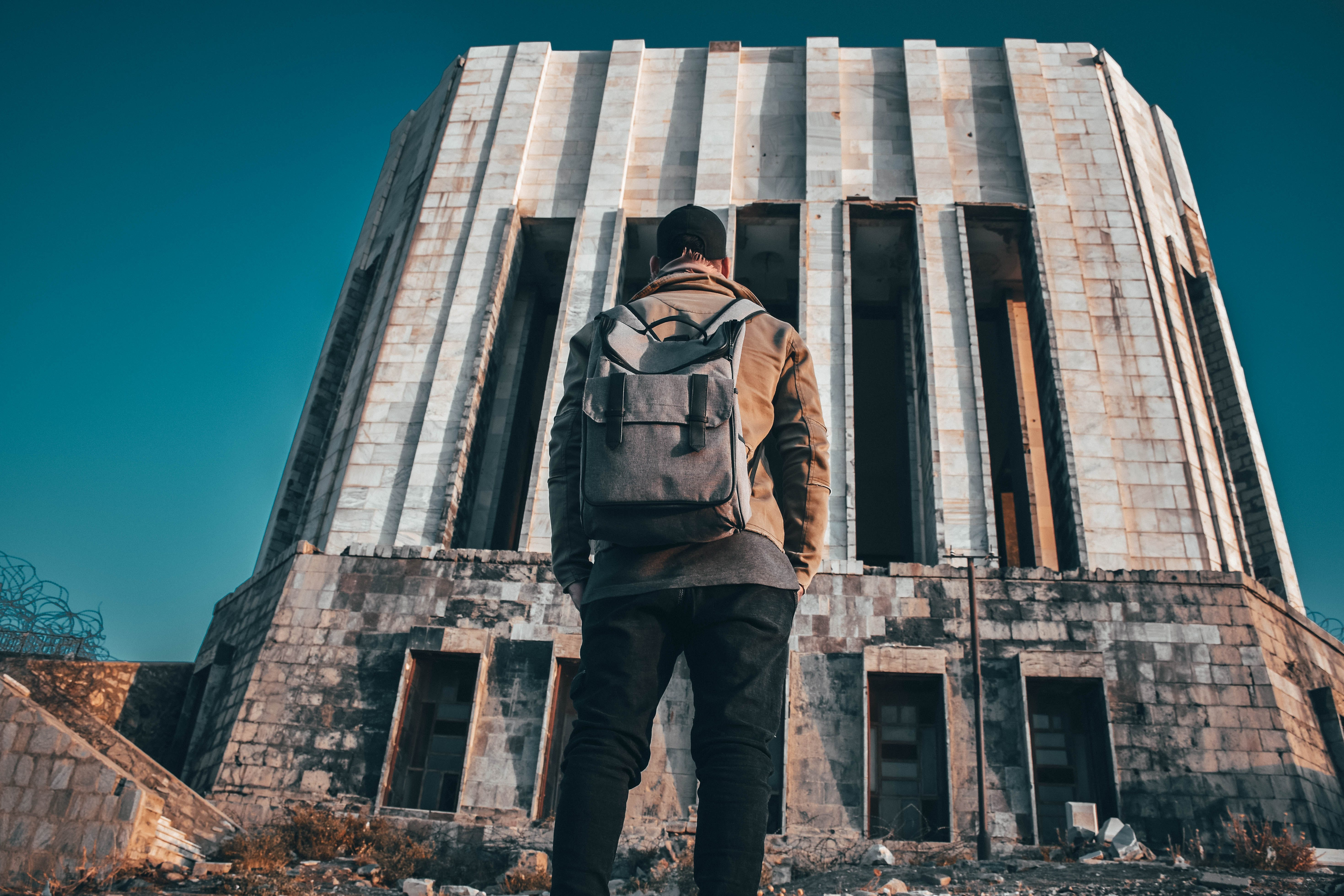 Man Standing In Front of the Building
