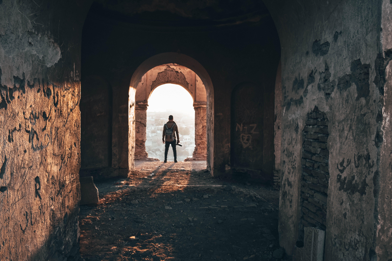 Man Standing On Arc Doorway