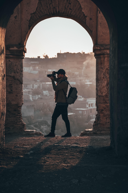 Photographer Capturing Inside Ruins