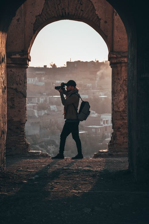 Photographer Capturing Inside Ruins
