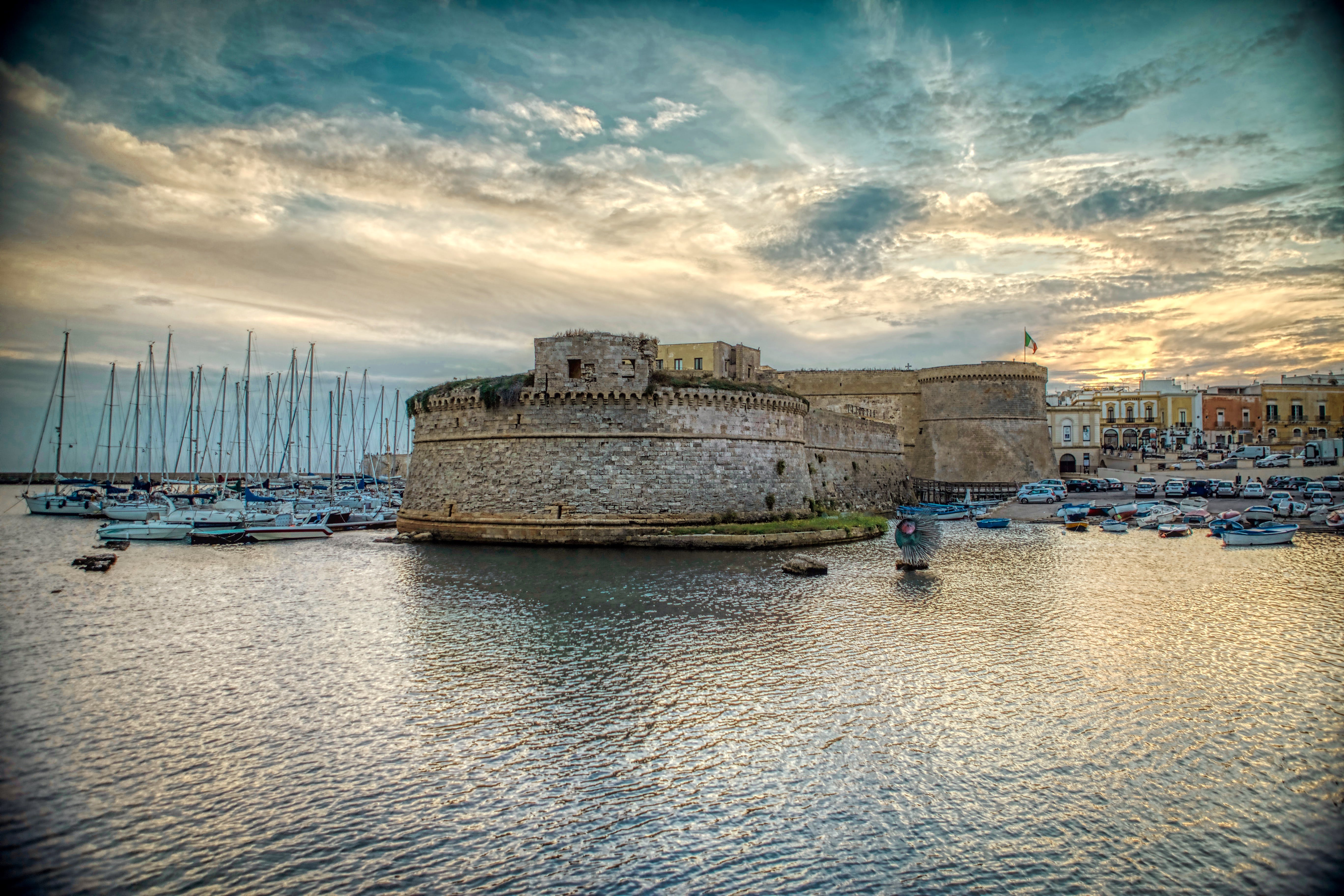 Free stock photo of boats, castle, clouds, evening sun