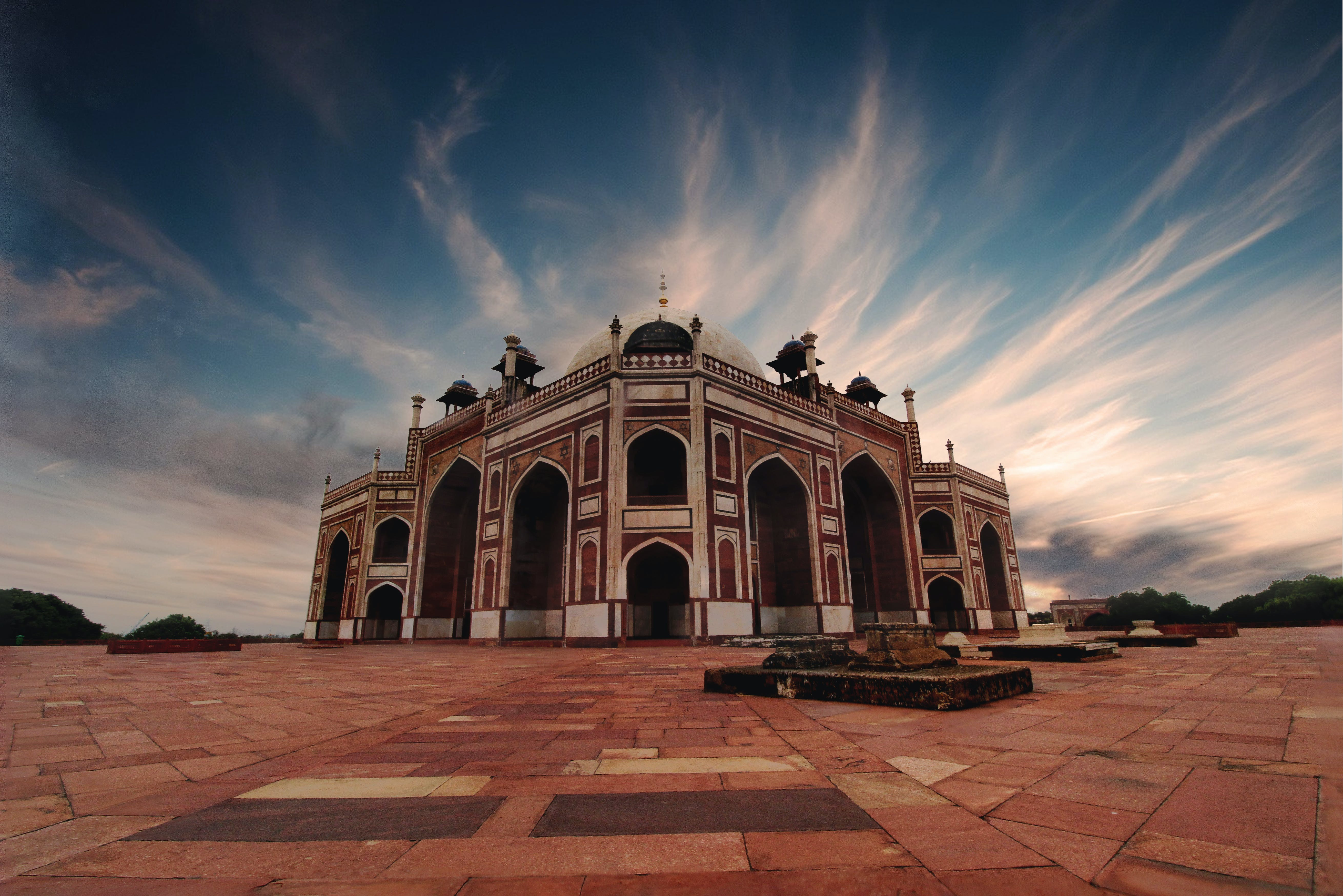 Brown and Black Mosque Under White and Blue Cloudy Sky