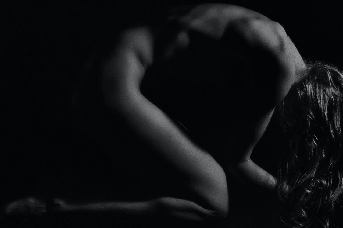 Grayscale Photo of Naked Person Kneeling