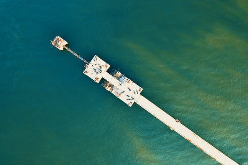 High Angle-photography of White Sea Dock on Green Water