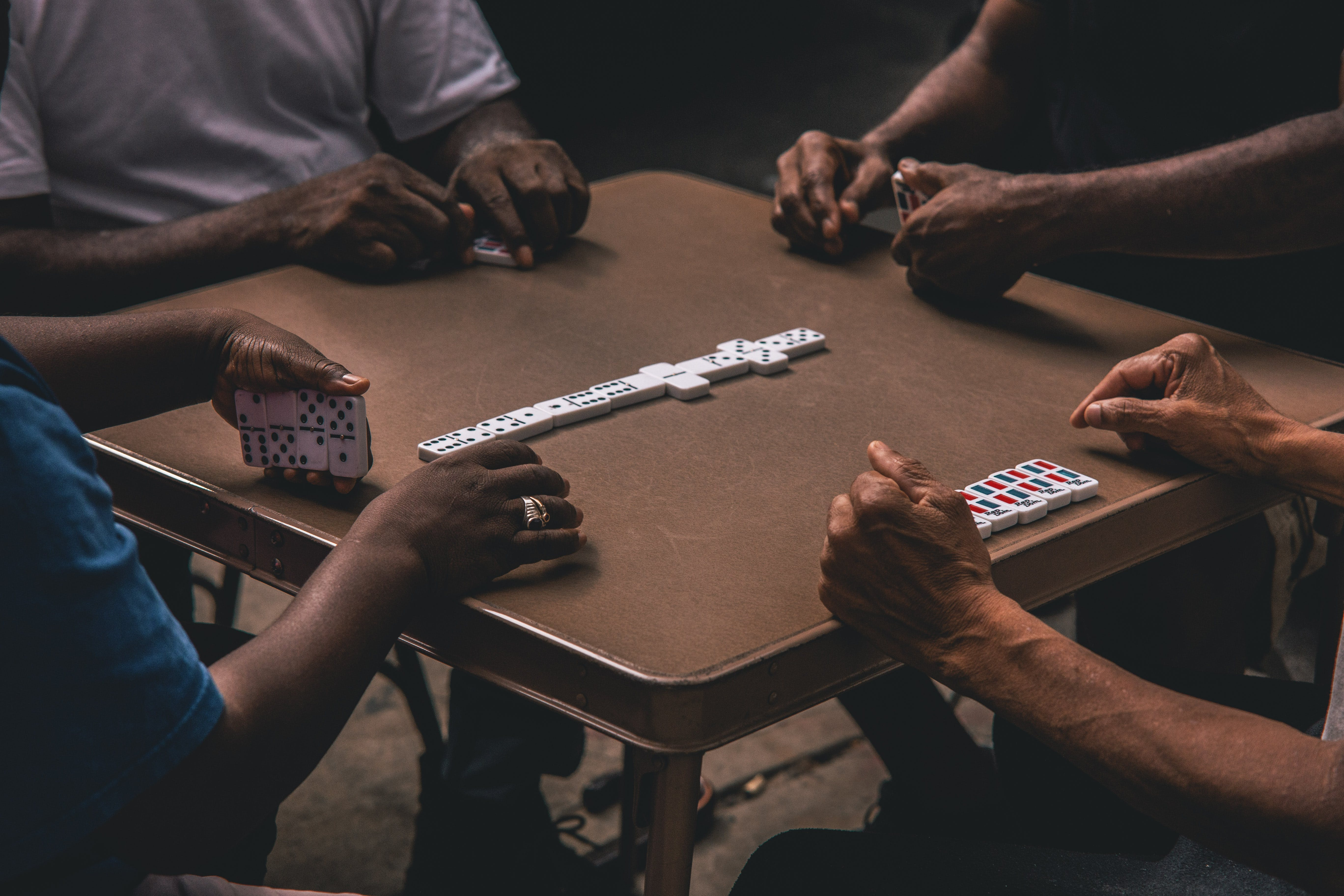 Four People Playing Dominoes
