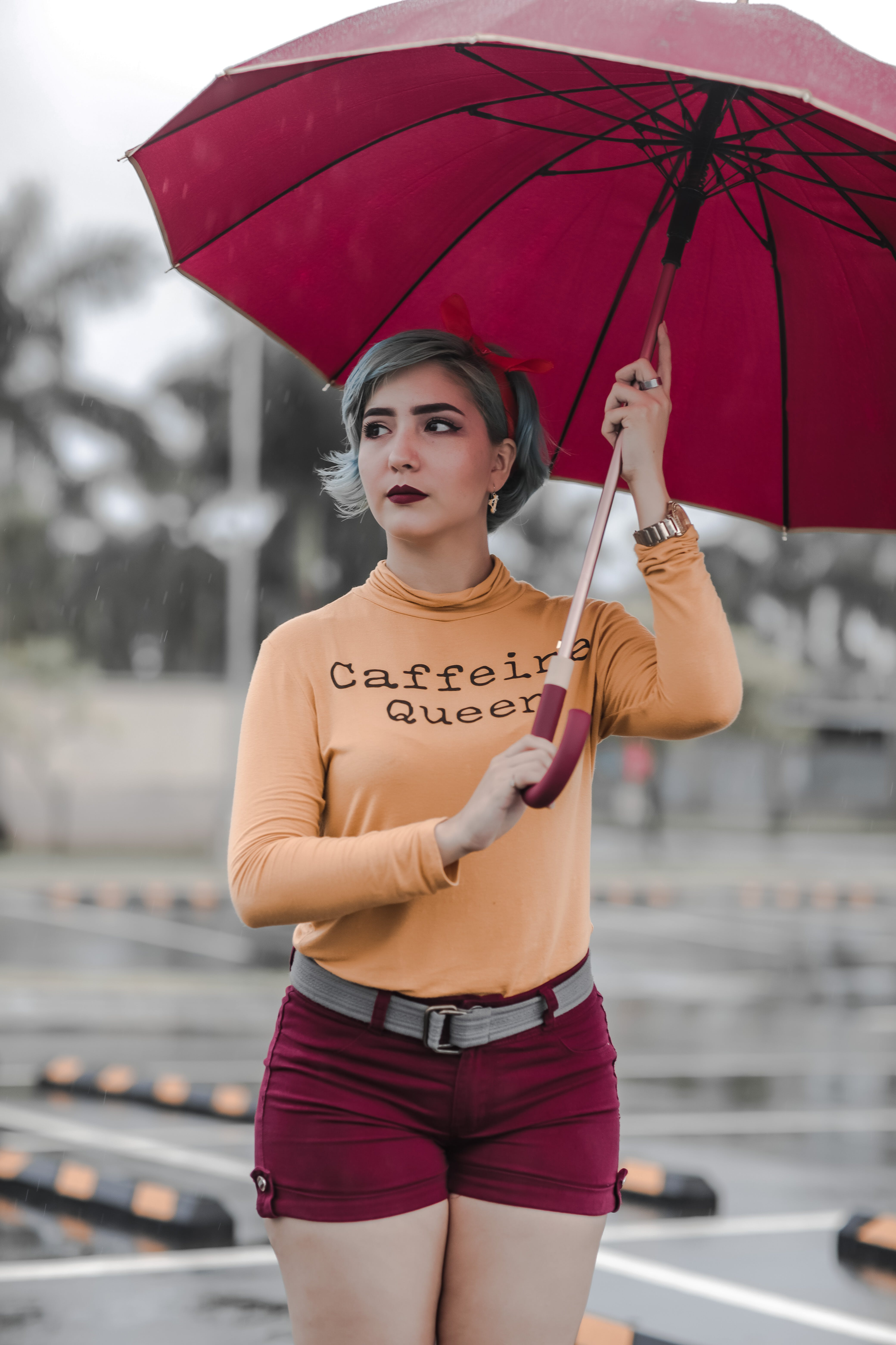 Woman Standing While Holding Umbrella