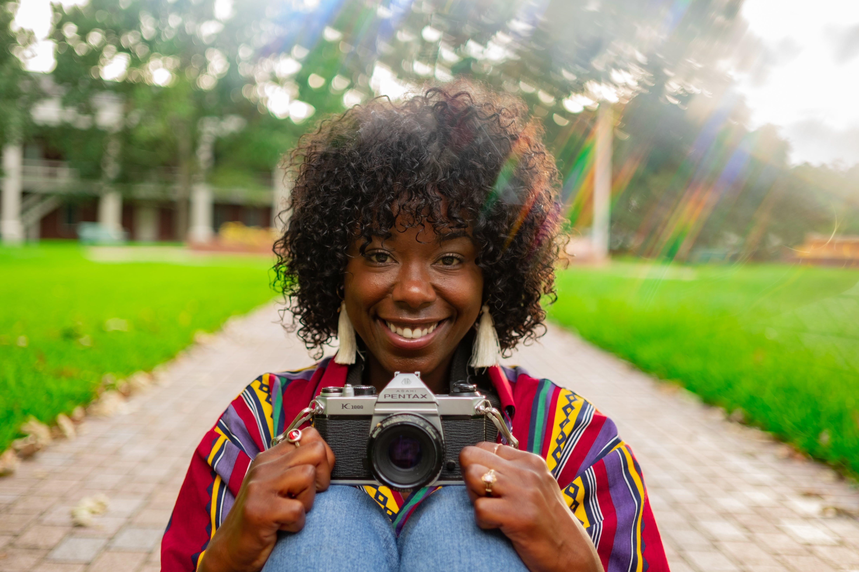 Woman Holding Grey Pentax Camera