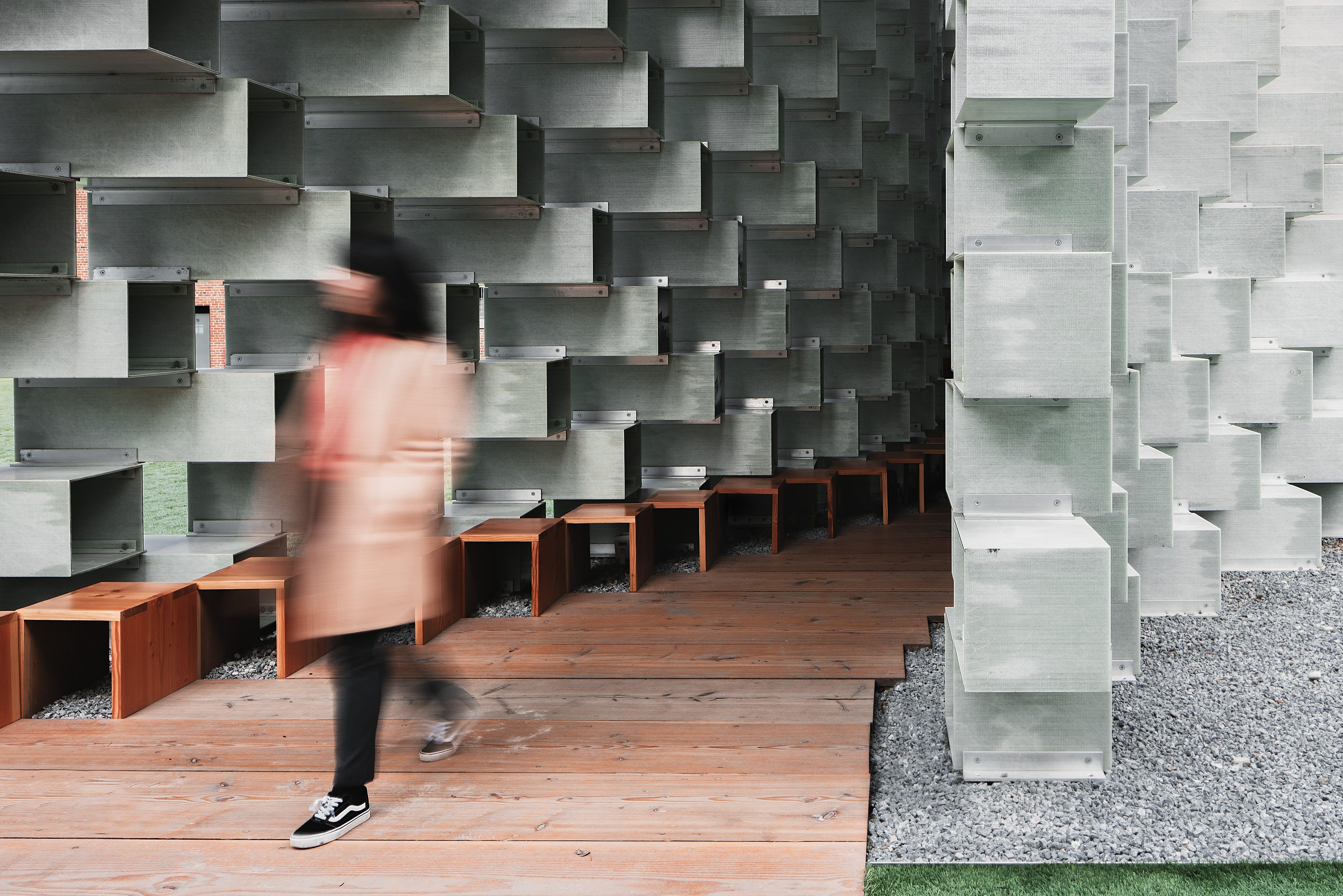 Woman Walks on Wooden Pathway