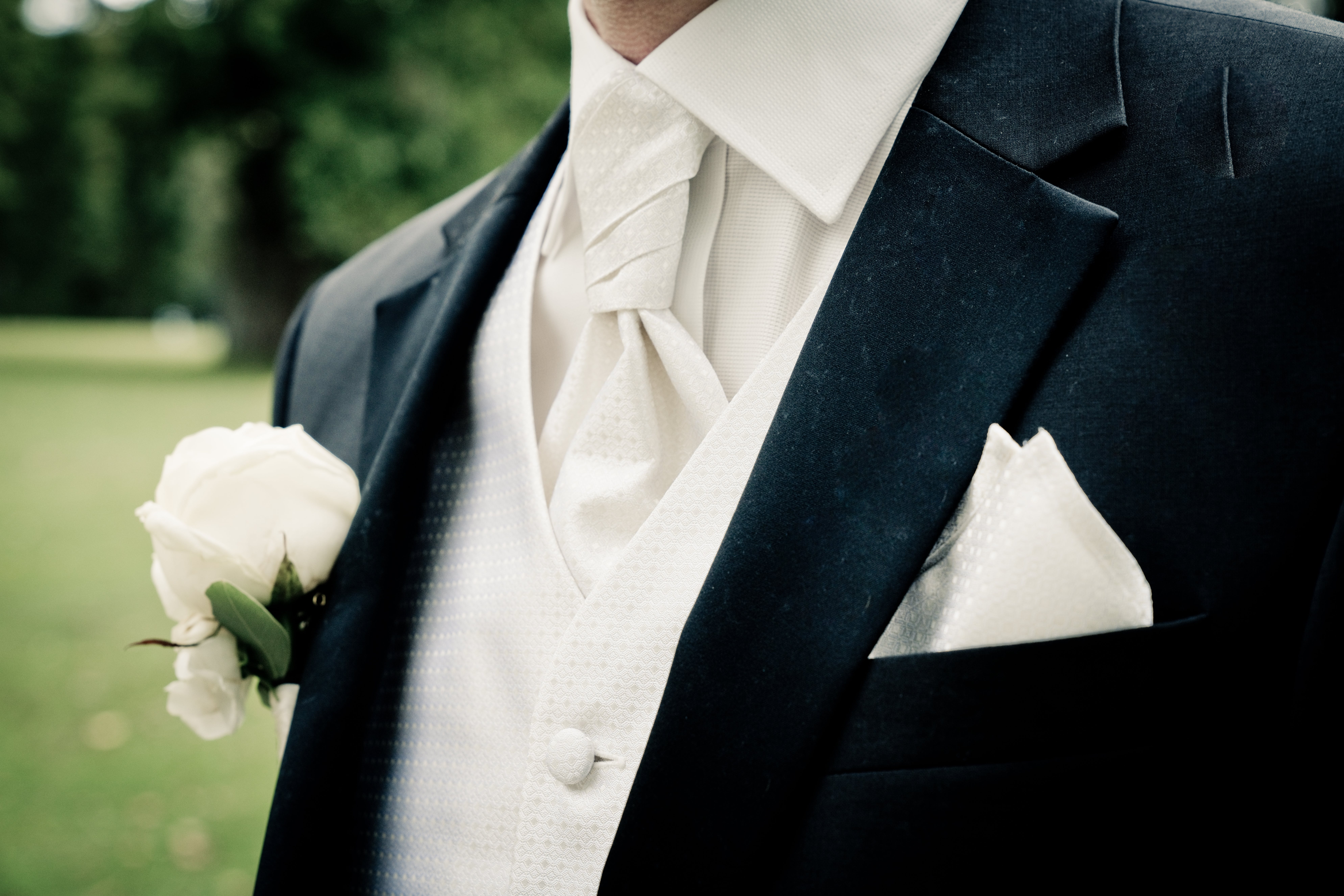 Man Wearing Suit in Close-up Photography