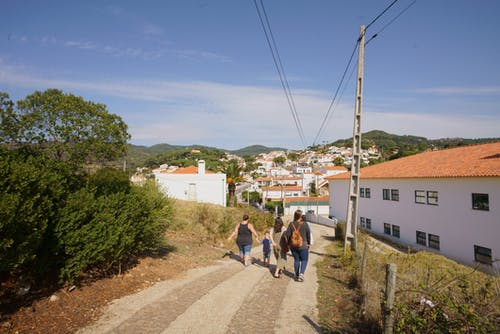 Group of People Walking on Road