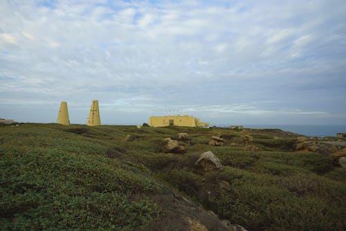 Fotos de stock gratuitas de campo, césped, cielo nublado, colina