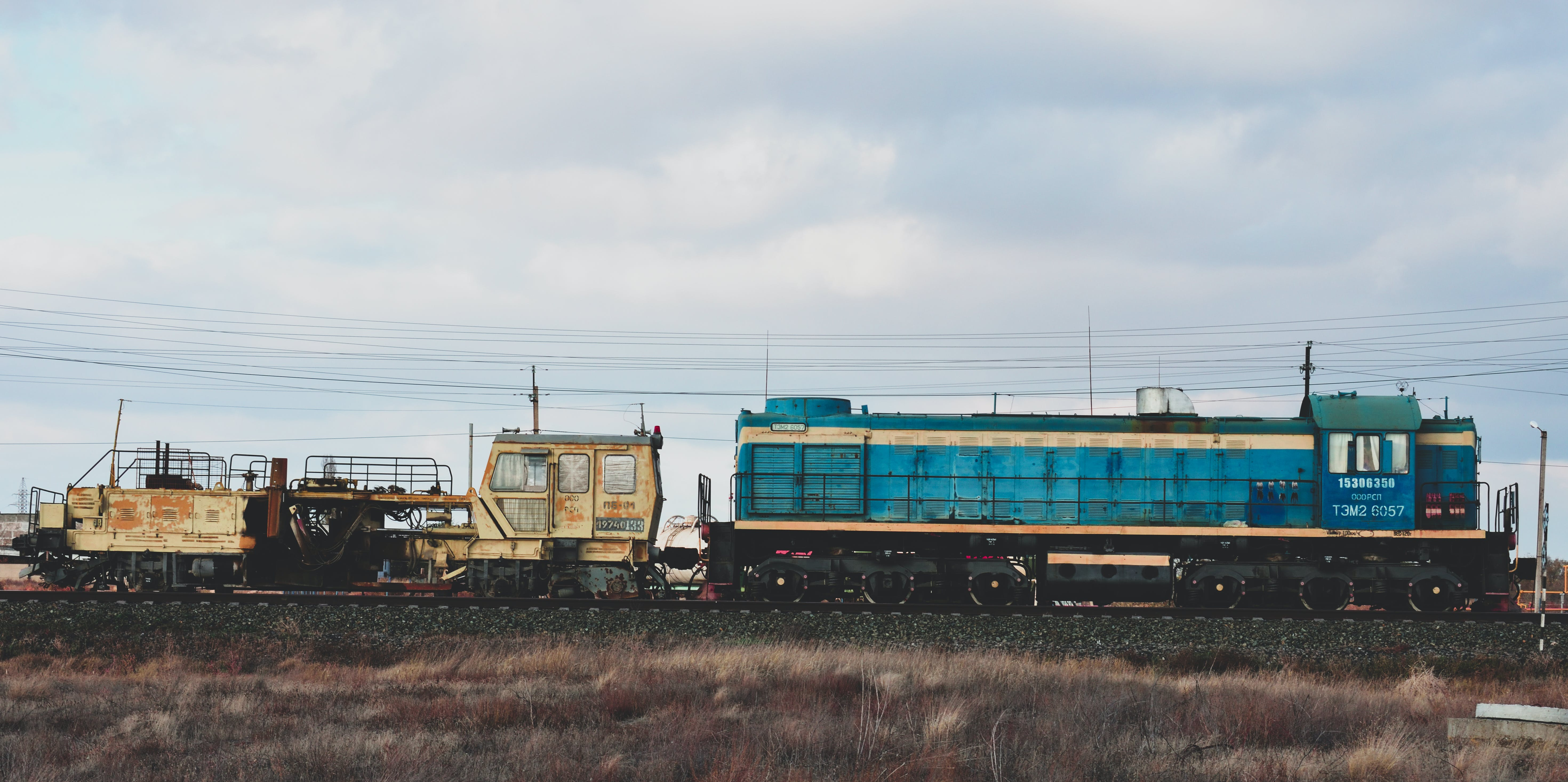Blue and Brown Train Beside Field
