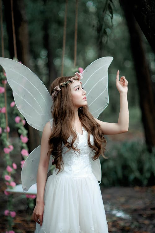 Woman in Fairy Costume Raising Hand