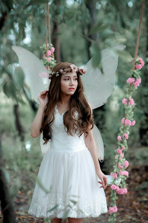Woman Doing Photoshoot While In Fairy Costume
