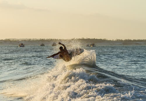Person Surfboarding
