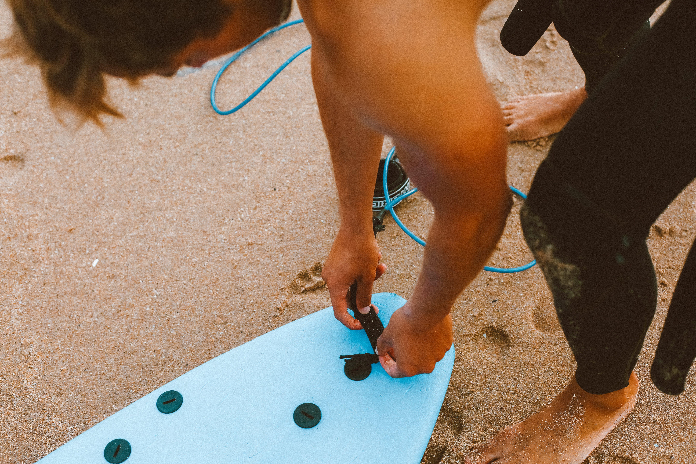 Man Touching Surfboard