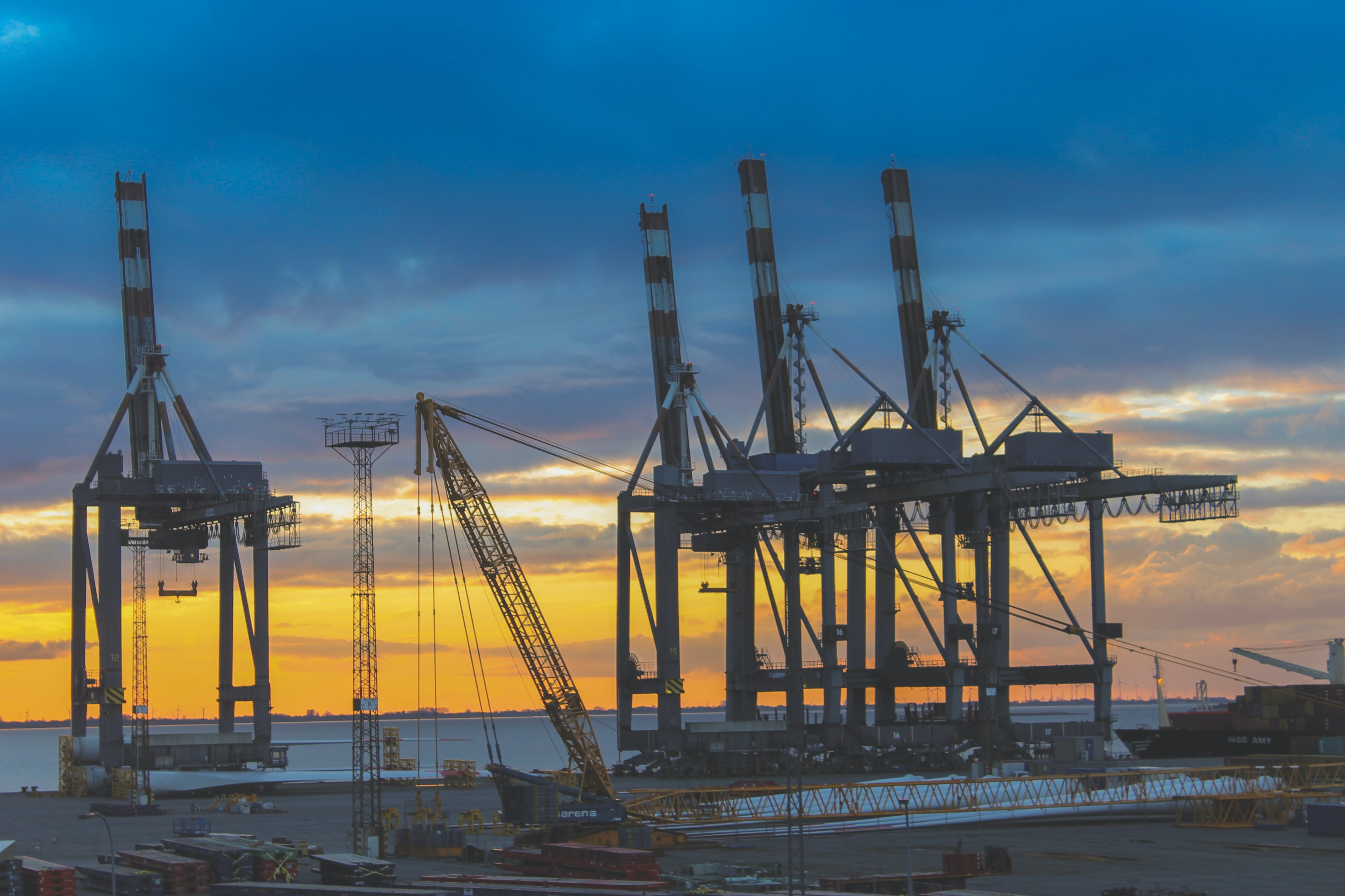 Free stock photo of port, container, harbour cranes, golden sunset