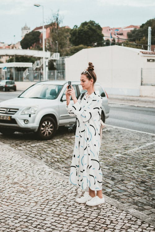 Woman Taking Photos with Smartphone