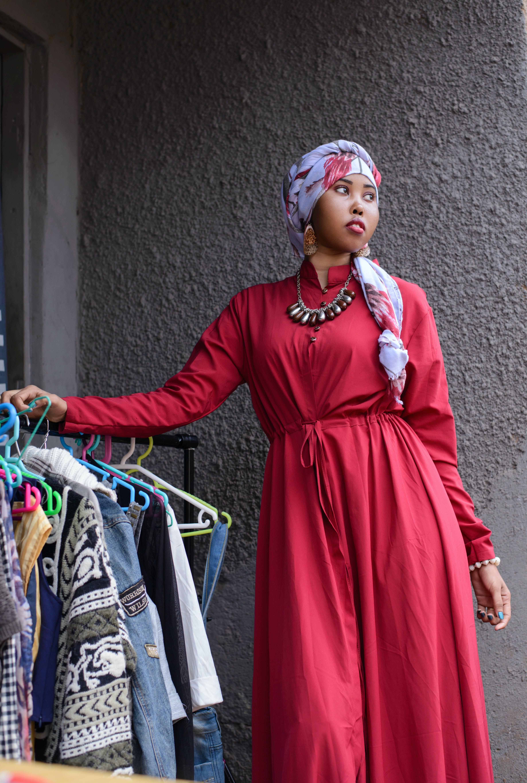 Woman Standing Near Black Metal Clothes Rack