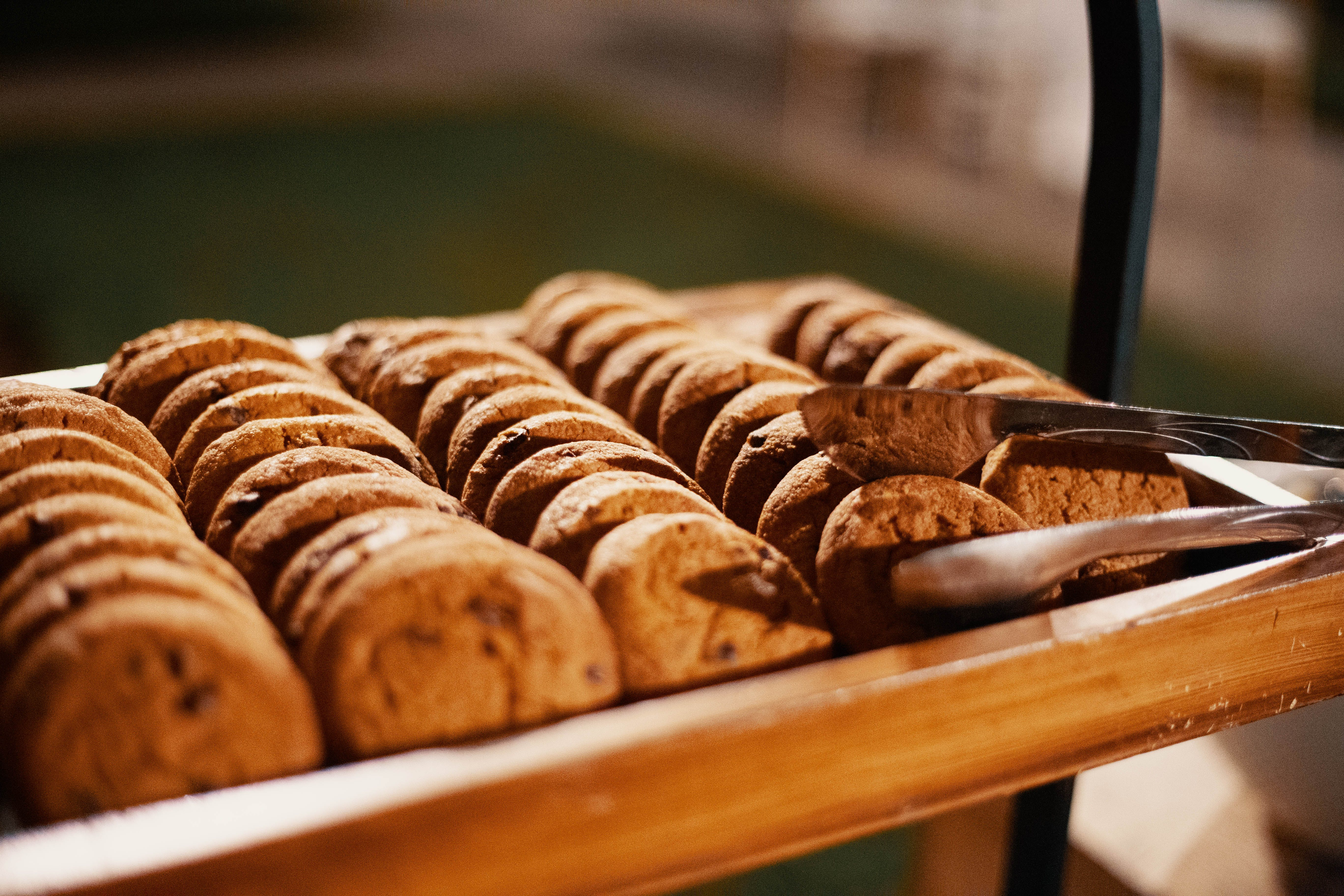 Selective Focus Photography of Baked Cookies With Gray Stainless Steel Tong