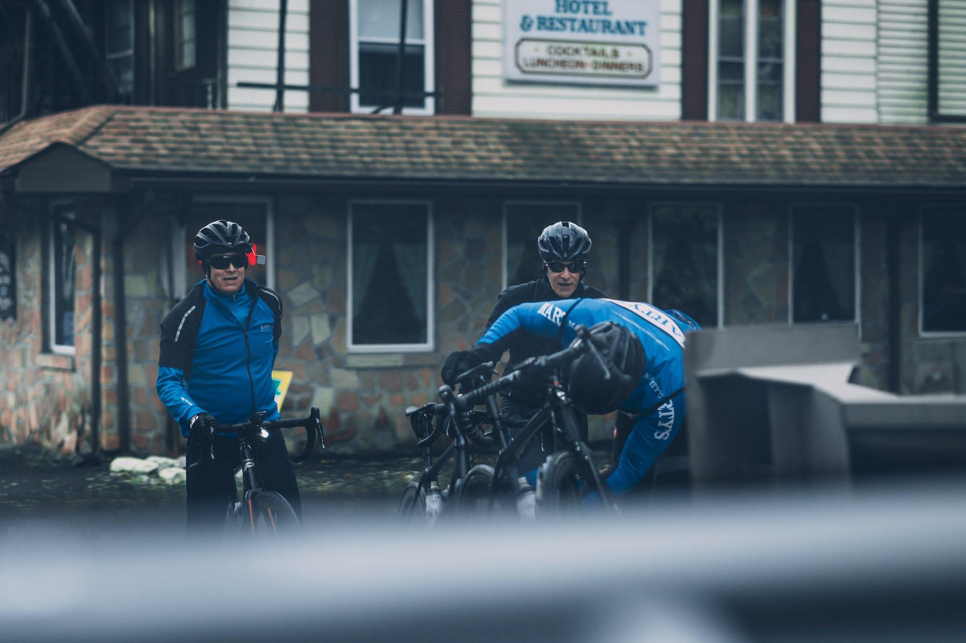 three bikers wearing helmet