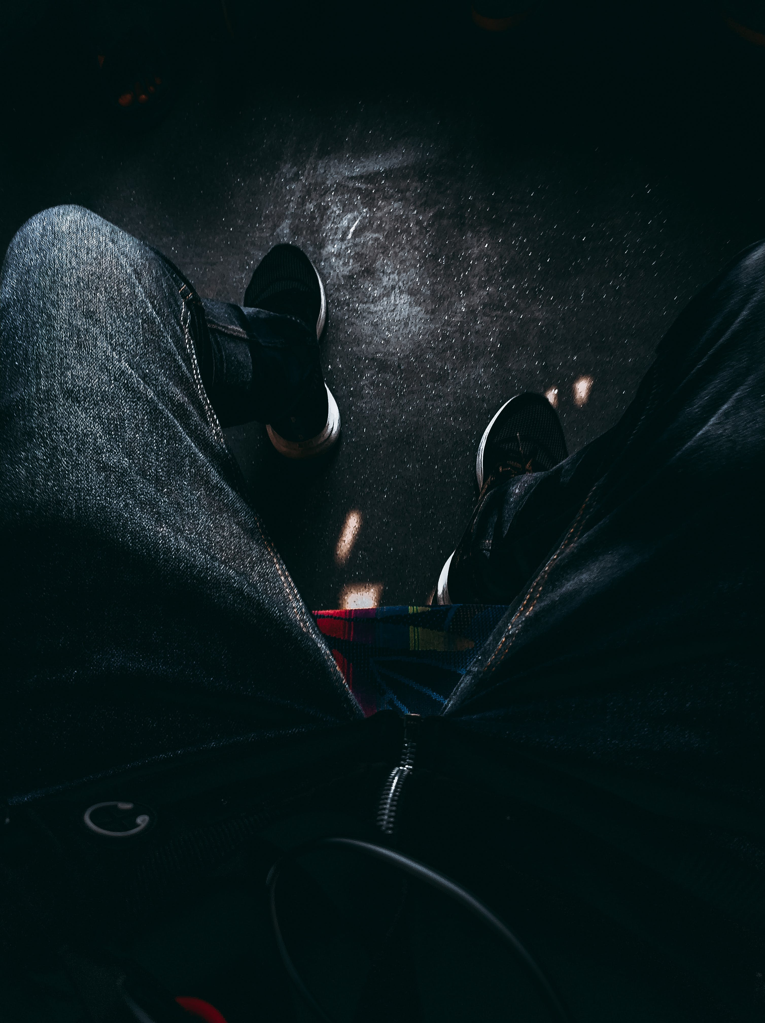 Person in Black Jeans and Shoes